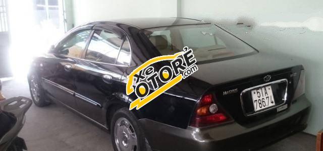 Gia đình có xe Daewoo Magnus MT đời 2005, màu đen số sàn, giá chỉ 235 triệu cần bán