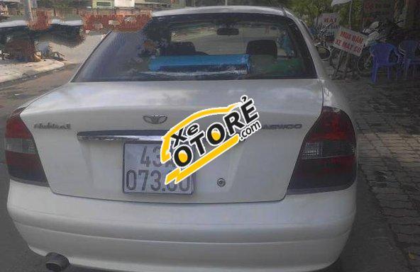 Mình cần bán lại xe Daewoo Nubira MT đời 2000, màu trắng số sàn giá cạnh tranh