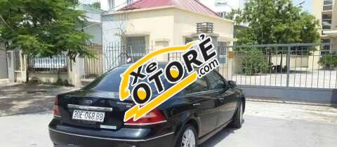 Tôi cần bán Ford Mondeo MT sản xuất 2003, màu đen số sàn