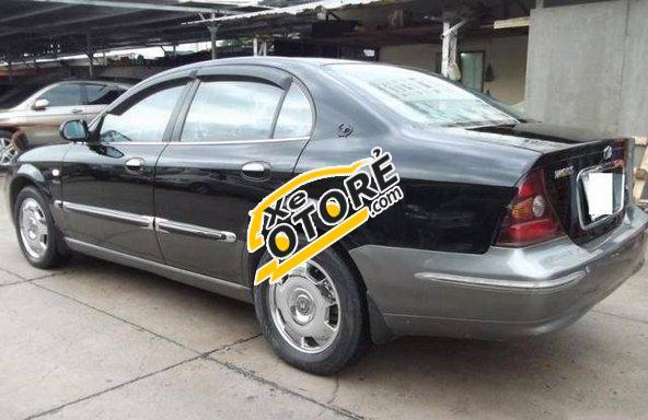 Tôi cần bán Daewoo Magnus MT đời 2004, màu đen số sàn giá cạnh tranh