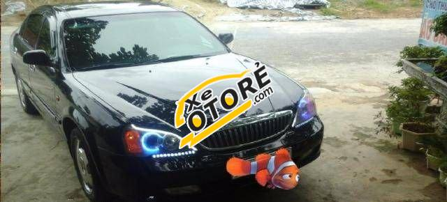 Gia đình bán ô tô Daewoo Magnus MT 2004, màu đen số sàn, giá chỉ 220 triệu