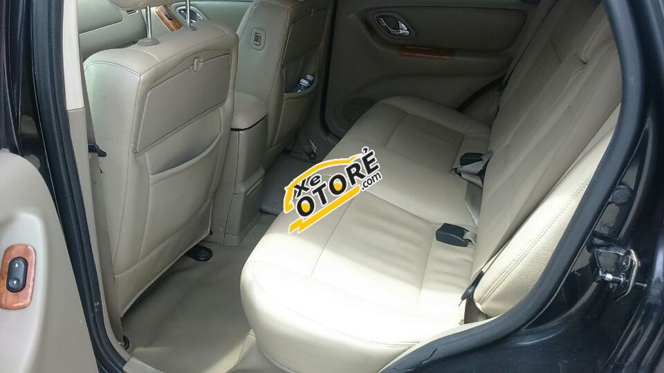 Bán ô tô Ford Escape 3.0L XLT đời 2004, màu đen Full option