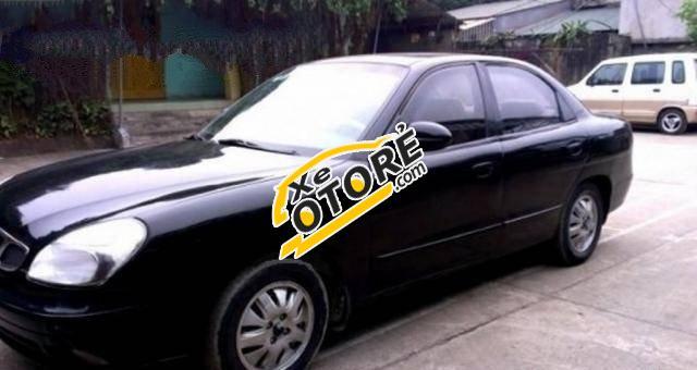 Mình bán Daewoo Nubira MT đời 2002, màu đen số sàn