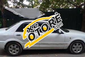 Gia đình cần bán Ford Laser MT đời 2002, màu trắng số sàn, giá tốt