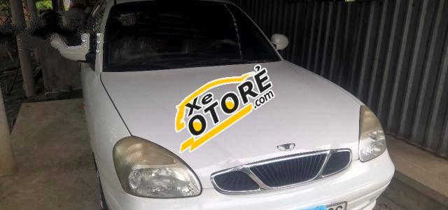 Em cần bán Daewoo Nubira MT 2003, màu trắng số sàn
