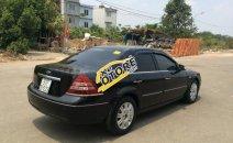 Em cần bán gấp Ford Mondeo 2.5 V6 sản xuất 2004, màu đen số tự động