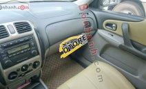 Cần bán Ford Laser Delu đời 2001, màu vàng