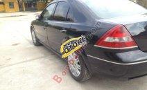 Xe Ford Mondeo 2.5 V6 đời 2004, màu đen số tự động