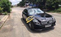Cần bán Mercedes E400 AMG đời 2014, màu đen