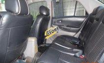 Cần bán lại xe Ford Laser GHIA đời 2003, màu đỏ xe gia đình