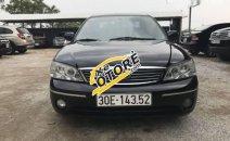 Cần bán lại xe Ford Laser 1.8 AT 2004, màu đen số tự động giá cạnh tranh