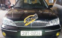 Chính chủ cần bán xe Ford Laser GHIA 1.8 sản xuất năm 2003, màu đen, giá cạnh tranh