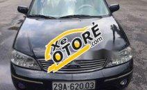 Cần bán Ford Laser 1.8AT 2004, màu đen