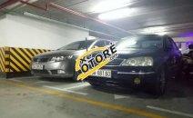 Bán Ford Laser 1.8AT sản xuất năm 2004, màu đen, giá chỉ 229 triệu