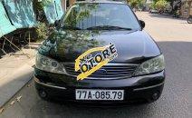 Cần bán lại xe Ford Laser Ghia 1.8 đời 2003, màu đen, giá chỉ 205 triệu