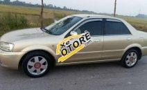 Cần bán Ford Laser 1.8MT năm 2003, màu vàng chính chủ giá cạnh tranh