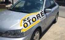 Cần bán gấp Ford Laser GHIA 1.8 2003, màu bạc số sàn, 203tr