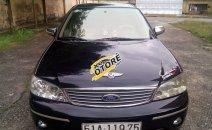 Bán Ford Laser GHIA 2004, màu đen chính chủ, giá 242tr