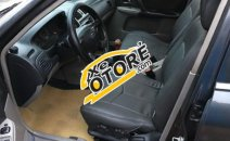 Cần bán xe Ford Laser 1.8 MT đời 2002, màu đen