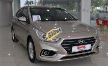 Cần bán xe Hyundai Acent 1.4MT đời 2018 ghi vàng