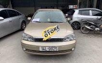 Cần bán gấp Ford Laser 1.8 MT sản xuất 2003, màu vàng