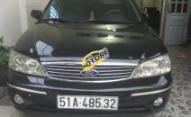 Bán Ford Laser 1.8 2004, màu đen