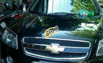 Cần bán xe Chevrolet Captiva LT đăng ký 2010, màu đen, xe gia đình, giá tốt 347tr