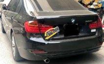 Bán xe BMW 3 Series 320i sản xuất 2012, màu đen, nhập khẩu còn mới