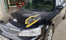 Cần bán xe Ford Laser Ghia sản xuất năm 2004, màu đen