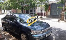 Bán xe Ford Laser, gia đình đang đi tại Đà Nẵng
