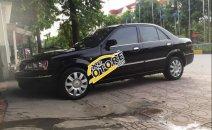 Bán Ford Laser 1.8MT 2003, màu đen, xe còn mới