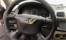 Cần bán xe Ford Laser 1.8 năm sản xuất 2002, màu xám
