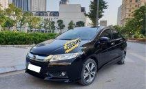 Cần bán lại xe Honda City 1.5 AT sản xuất năm 2014, màu đen xe gia đình