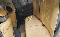 Cần bán gấp Ford Laser MT đời 2001, màu vàng xe gia đình