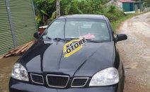Cần bán gấp Daewoo Lacetti sản xuất 2005, màu đen, 138tr