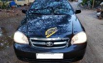 Cần bán lại xe Daewoo Lacetti EX sản xuất 2011, màu đen