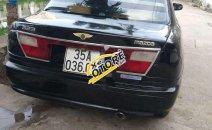 Cần bán Mazda 323F năm sản xuất 2000, màu đen, xe gia đình