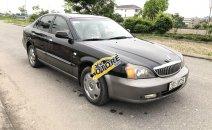 Cần bán Daewoo Magnus AT sản xuất 2005, màu đen, nhập khẩu