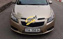 Cần bán lại xe Chevrolet Cruze sản xuất năm 2011, màu vàng cát