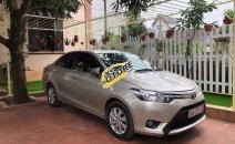 Bán Toyota Vios đời 2015, màu vàng cát, số sàn