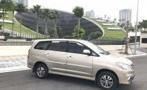 Cần bán gấp Toyota Innova E sản xuất 2015, màu vàng, chính chủ, 388tr