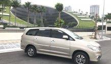 Cần bán gấp Toyota Innova E sản xuất 2015, màu vàng, chính chủ, 405tr